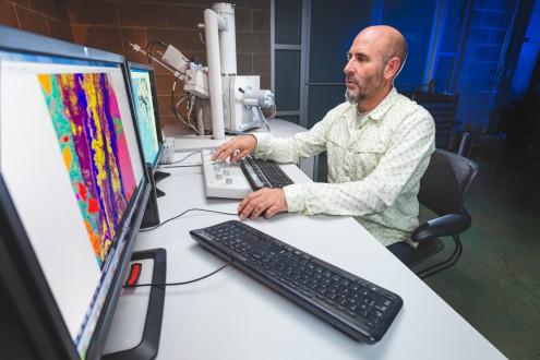 Concrete petrographer David Rothstein at work on the FEI Quanta 250 Environmental Scanning Electron Microscope